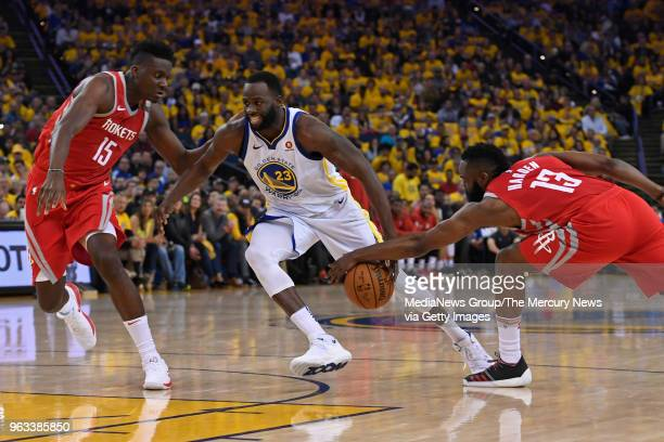 Houston Rockets' James Harden steals the ball from Golden State Warriors' Draymond Green during the second quarter of Game 6 of the NBA Western...