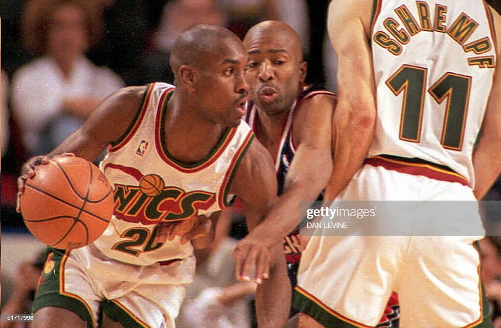 Houston Rockets Kenny Smith (C) gets squeezed out on a screen play by Seattle Supersonic Detlef Schrempf (R) as his teammate Gary Payton (L) dribbles past during game one of their Western Conference semifinal series on 04 May in Seattle. Seattle won 108-75.
