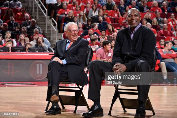 Houston Rockets owner Leslie Alexander and Hakeem Olajuwon during Yao Ming's jersey retirement ceremony at halftime of the game between the Houston...