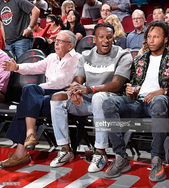 Houston Rockets owner Leslie Alexander and Houston Texan DeAndre Hopkins attend the Dallas Mavericks game against the Houston Rockets on October 30...