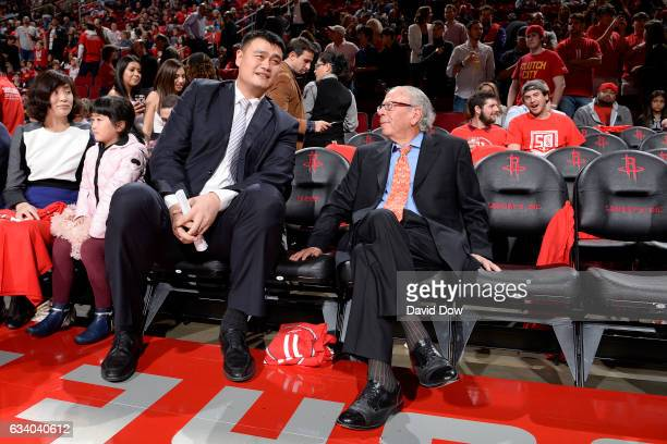Houston Rockets owner Leslie Alexander and NBA Legend Yao Ming talk during his jersey retirement ceremony during the Chicago Bulls game against the...