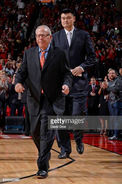 Houston Rockets owner Leslie Alexander and NBA Legend Yao Ming walk on the court for his jersey retirement ceremony during the Chicago Bulls game...