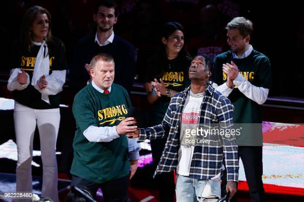 Houston Rockets Owner Tilman Fertitta and Music artist Travis Scott speak as part of a tribute to honor the victims of the May 18th shooting that...