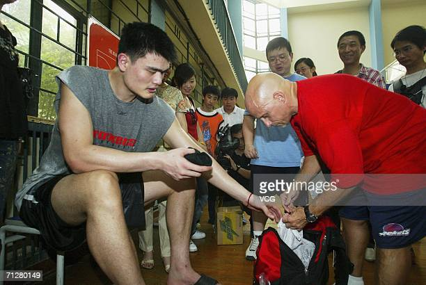 NBA Houston Rockets player Yao Ming trains June 23 2006 in Shanghai China Yao broke his left foot while playing against the Utah Jazz in April and...