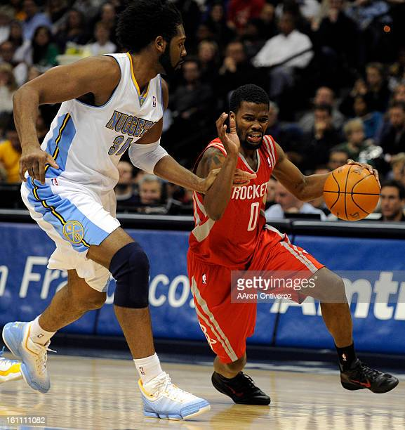 Houston Rockets point guard Aaron Brooks drives past Denver Nuggets center Nene during the second quarter on Monday January 3 2011 at the Pepsi...