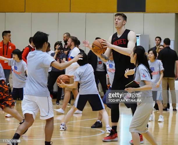 Houston Rockets power forward Isaiah Hartenstein provides instructions during an NBA Cares basketball clinic by the team in Tokyo on October 7 2019...