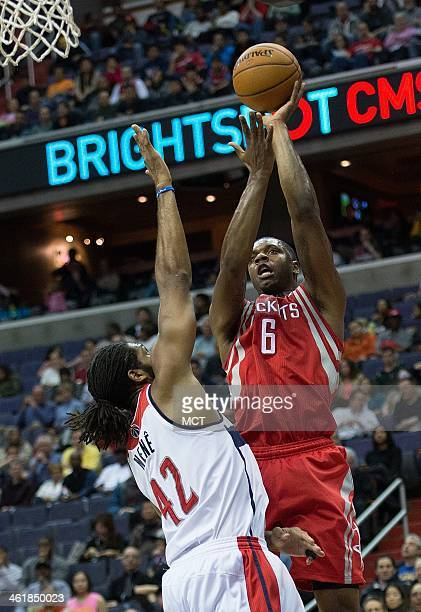 Houston Rockets power forward Terrence Jones shoots over Washington Wizards power forward Nene Hilario during the first half of their game played at...