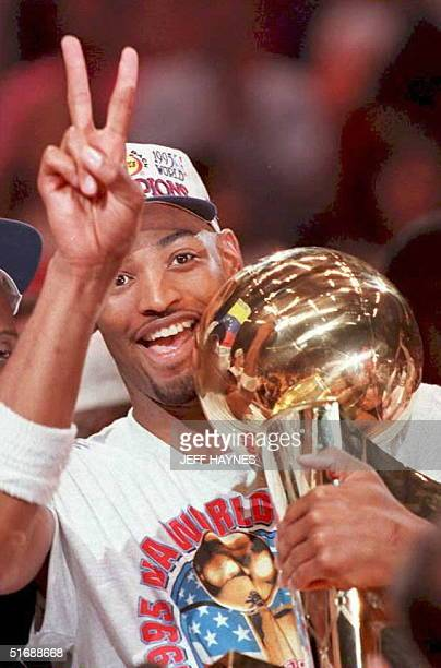 Houston Rockets Robert Horry holds the NBA Championship trophy 14 June after his teams 113101 victory over the Orlando Magic in game four of the NBA...