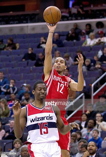 Houston Rockets shooting guard Kevin Martin follows through on a shot after being fouled by Washington Wizards shooting guard Jordan Crawford during...