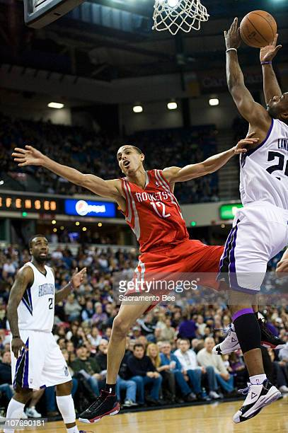 Houston Rockets shooting guard Kevin Martin is fouled by Sacramento Kings power forward Carl Landry in the second half at ARCO Arena Sunday December...