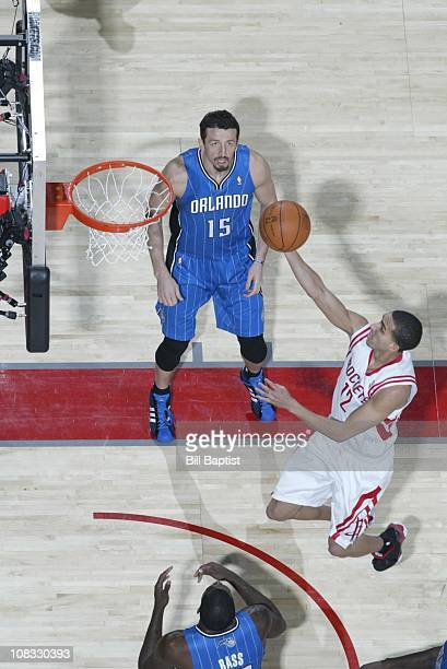 Houston Rockets shooting guard Kevin Martin Orlando Magic small forward goes to the basket as Hedo Turkoglu looks on on during the game against the...