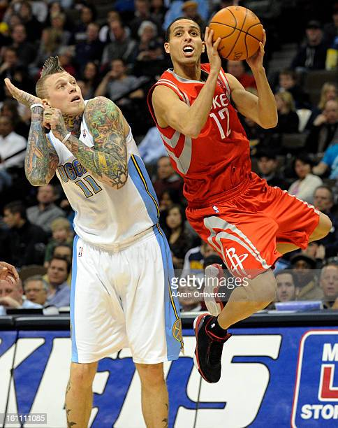 Houston Rockets shooting guard Kevin Martin shoots as Denver Nuggets center Chris Andersen pulls back his defense during the second quarter on Monday...