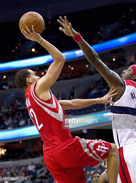 Houston Rockets shooting guard Kevin Martin shoots over Washington Wizards power forward Andray Blatche during their game played at the Verizon...