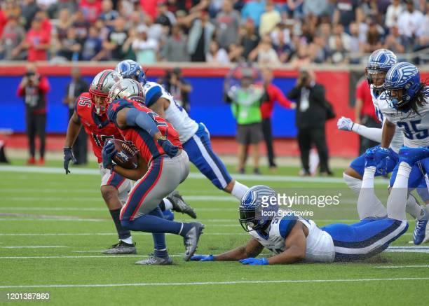 Houston Roughnecks cornerback Ajene Harris evades a tackle by St Louis Battlehawks linebacker Steve Beauharnais during the XFL game between the St...