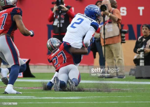 Houston Roughnecks cornerback Ajene Harris tackles St Louis Battlehawks wide receiver L'Damian Washington during the XFL game between the St Louis...