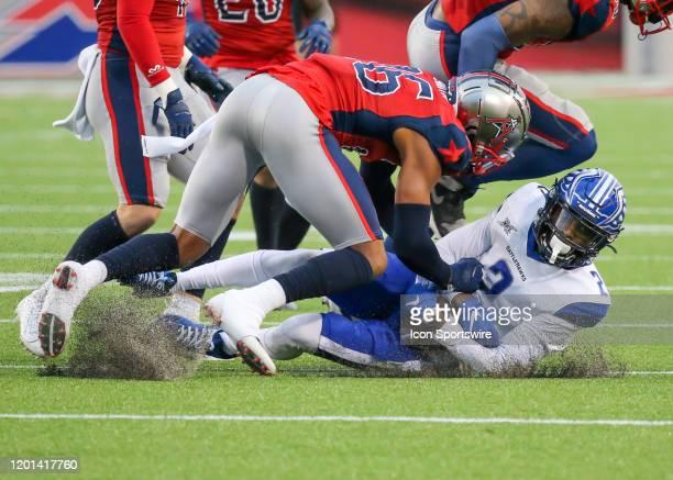 Houston Roughnecks cornerback Saivion Smith tackles St Louis Battlehawks wide receiver L'Damian Washington during the XFL game between the St Louis...
