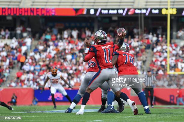 Houston Roughnecks quarterback PJ Walker looks to throw to his left during the XFL football game between the Los Angeles Wildcats and Houston...