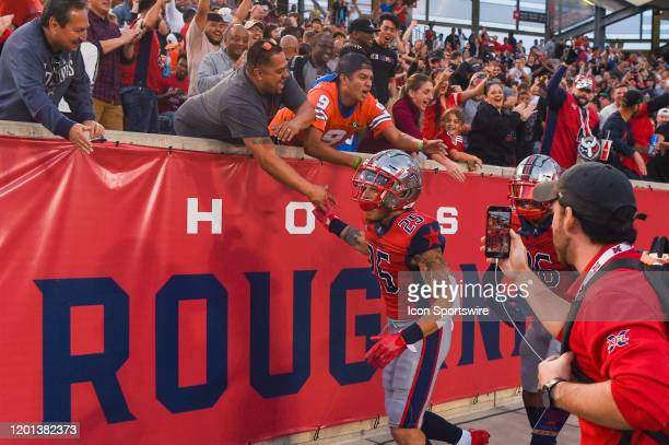 Houston Roughnecks safety Cody Brown celebrates with wild Roughneck fans after he returned a first half pass interception to the one yard line during...