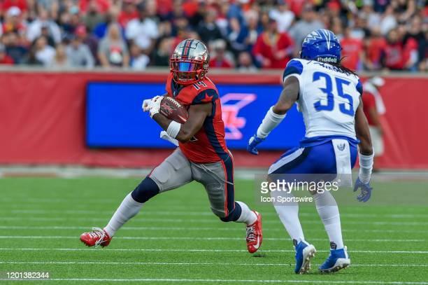 Houston Roughnecks wide receiver Cam Phillips looks for running room after a short pass reception as St Louis Battlehawks cornerback D'Montre Wade...