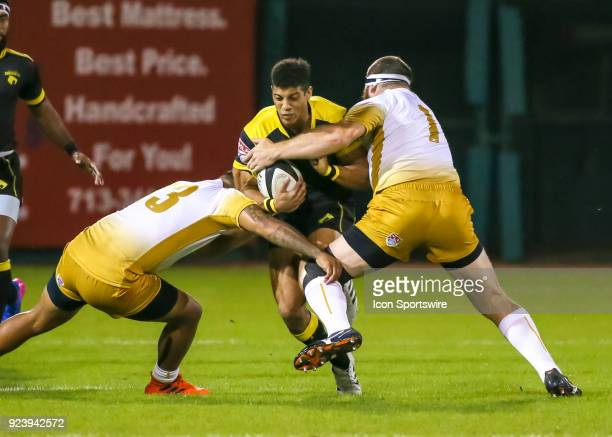 Houston SaberCats center Malacchi Esdale gets tackled by New Orleans Gold prop Ben Tarr and New Orleans Gold prop Hubert Buydens during the Major...