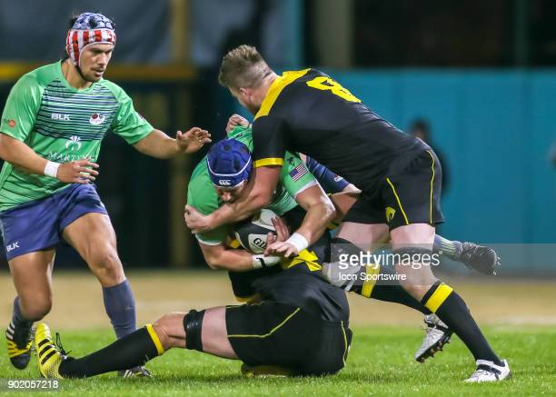 Houston SaberCats eightman Matt Trouville tackles Seattle Saracens lock Nick McKenna during the opening rugby match between the Seattle Saracens and...