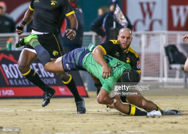 Houston SaberCats flanker Kyle Sumsion tackles Seattle Saracens inside center Mike Garrity during the opening rugby match between the Seattle...