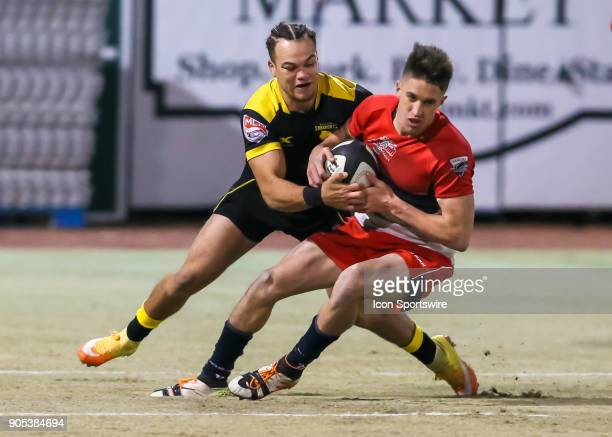 Houston SaberCats flyhalf Chris Slater brings down Vancouver Ravens fullback Aaron McLellan during the rugby match between the Vancouver Ravens and...