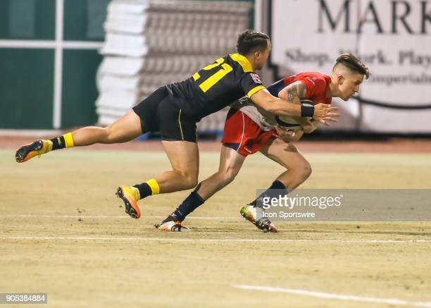 Houston SaberCats flyhalf Chris Slater tackles Vancouver Ravens fullback Aaron McLellan during the rugby match between the Vancouver Ravens and...