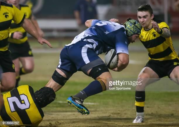 Houston SaberCats flyhalf Kieran Farmer blocks Capital Selects lock Matt Holsopple during the Major League Rugby match between the Capital Selects...