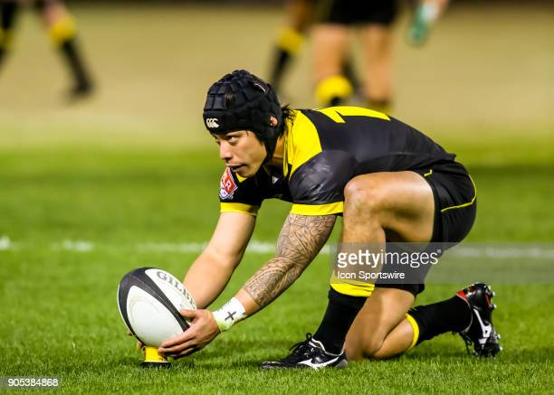 Houston SaberCats fullback Zach Pangelinan sets the ball for an extra point kick during the rugby match between the Vancouver Ravens and Houston...