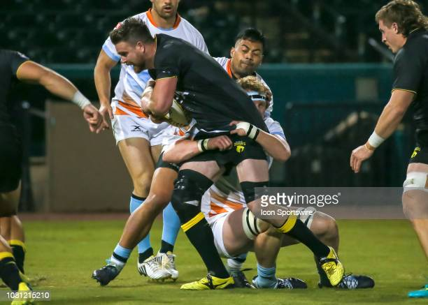 Houston SaberCats lock Matt Trouville gets tackled by Austin Elite lock Ben Mitchell during the preseason exhibition rugby match between the Austin...
