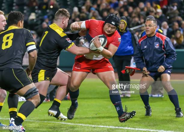 Houston SaberCats prop Jamie Dever reaches to take the ball from Vancouver Ravens hooker Paul Ahn during the rugby match between the Vancouver Ravens...