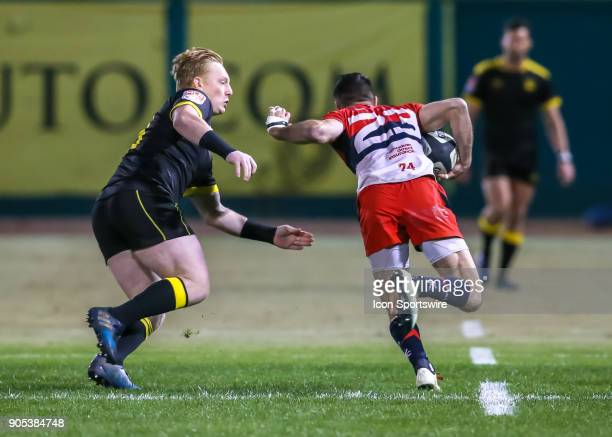 Houston SaberCats scrumhalf Conor Murphy reaches out to tackle Vancouver Ravens center James Thompson during the rugby match between the Vancouver...