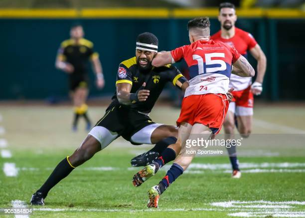 Houston SaberCats wing Josua Vici blocks Vancouver Ravens fullback Aaron McLellan during the rugby match between the Vancouver Ravens and Houston...