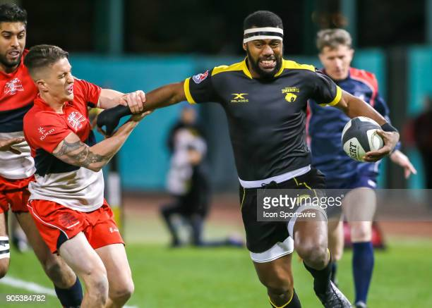 Houston SaberCats wing Josua Vici pushes away Vancouver Ravens fullback Aaron McLellan during the rugby match between the Vancouver Ravens and...