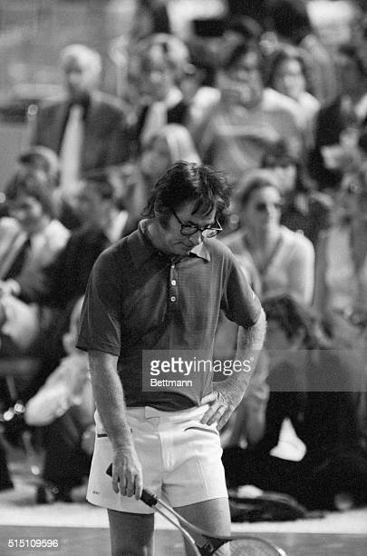 Tennis hustler Bobby Riggs is deep in thought as he stands 64 63 going into the third set which he lost to Billie Jean King 63 to lose a $100000...