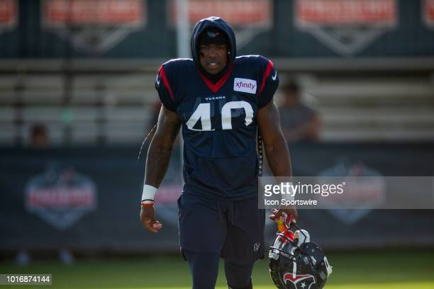 Houston Texan RB Lavon Coleman enters the field prior to practice during Houston Texans Training Camp August 14 at Houston Methodist Training Center...