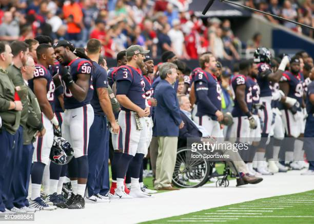 Houston Texans and former President George H W Bush watch the color guard during the football game between the Indianapolis Colts and Houston Texans...