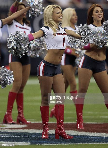 Houston Texans cheerleaders perform during a game between the Houston Texans and Oakland Raiders at Reliant Stadium on October 4 2009 in Houston Texas