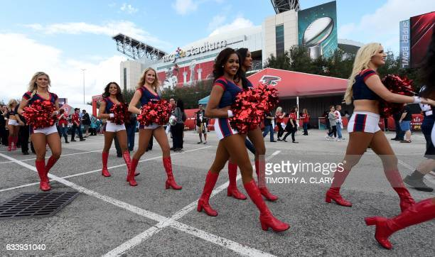 Houston Texans Cheerleaders perform for fans as they arrive for Super Bowl LI between the New England Patriots and the Atlanta Falcons at NGR Stadium...