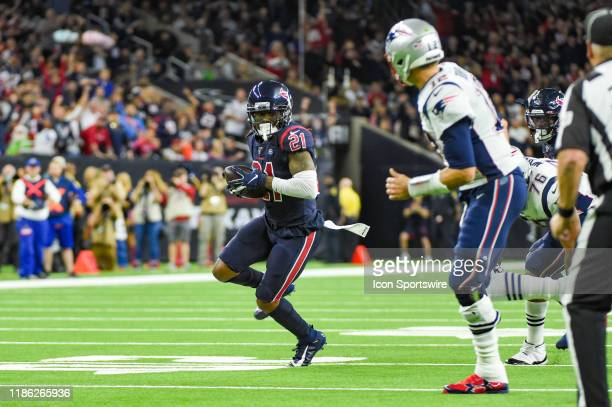 Houston Texans cornerback Bradley Roby returns a New England Patriots quarterback Tom Brady interception during the football game between the New...