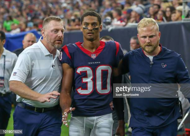 Houston Texans cornerback Kevin Johnson leaves the field after sustaining a concussion during the preseason football game between the San Francisco...