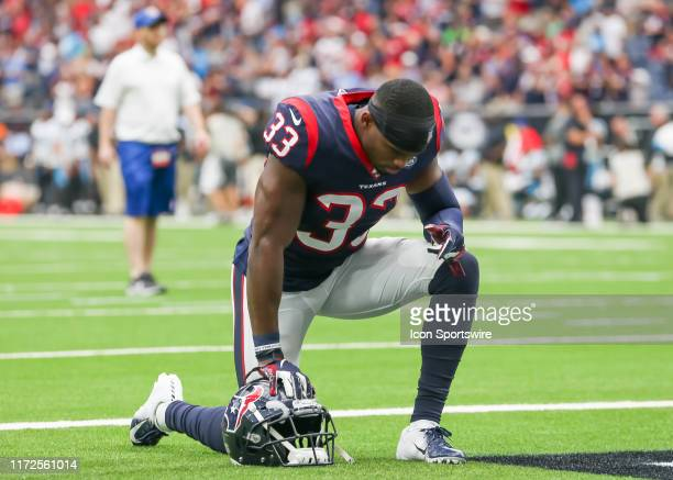 Houston Texans defensive back AJ Moore says a prayer during the football game between the Carolina Panthers and Houston Texans at NRG Stadium on...