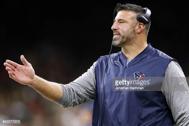 Houston Texans defensive coordinator Mike Vrabel reacts during the first half of a preseason game against the New Orleans Saints at the MercedesBenz...