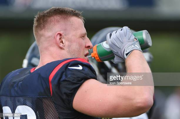 Houston Texans defensive end J.J. Watt cools off between drills during the Houston Texans Training Camp at the Houston Methodist Training Center on...