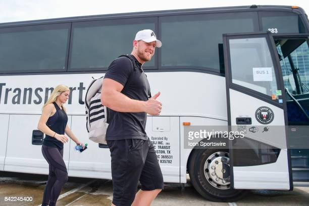Houston Texans defensive end JJ Watt gives a thumbs up and a big smile as he boards the bus during the JJ Watt and Houston Texans Hurricane Harvey...