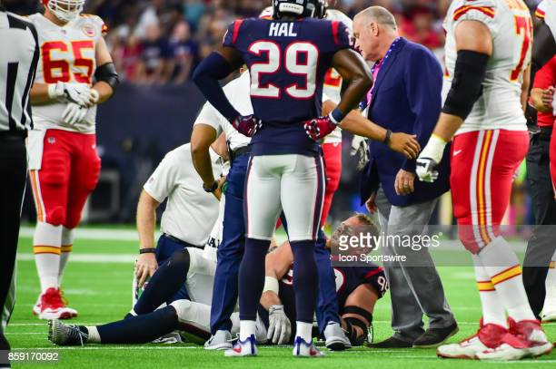 Houston Texans defensive end JJ Watt grimaces in pain after hurting his knee during first half action during the football game between the Kansas...