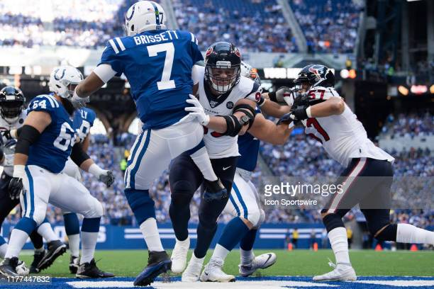 Houston Texans defensive end J.J. Watt hits Indianapolis Colts quarterback Jacoby Brissett during the NFL game between the Houston Texans and the...