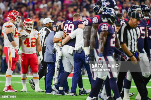 Houston Texans defensive end JJ Watt is helped from the field after a leg injury during the football game between the Kansas City Chiefs and Houston...