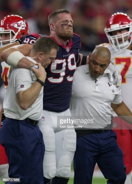 Houston Texans defensive end JJ Watt leaves the field after sustains an injury during the football game between the Kansas City Chiefs and Houston...